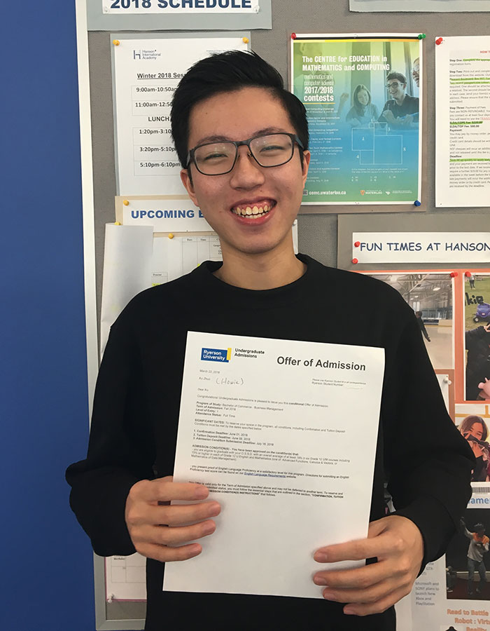 Man holding offer of admission from Ryerson University